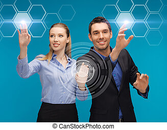 man and woman working with virtual screen - picture of man...