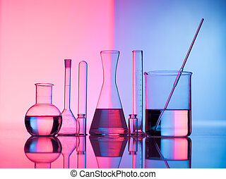 Glass science - Different laboratory glassware with water...