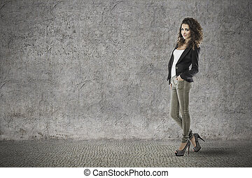 attractive woman with curly hair on vintage grunge...