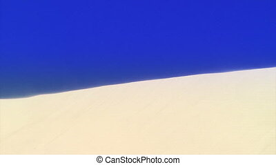 Wind blowing on sand dune