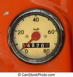Vintage Speedometer - A Vintage Speedometer On A Red Scooter