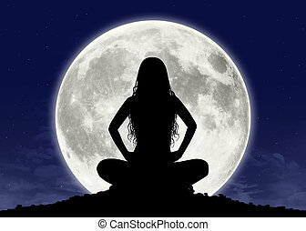 young woman in meditation at the full moon - silhouette of a...