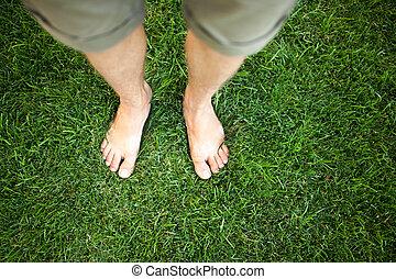 Feet relaxing in the grass
