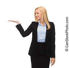 man showing something imaginary on her hand - smiling woman...