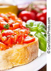 bruschetta with tomatoes - fresh bruschetta served on a...