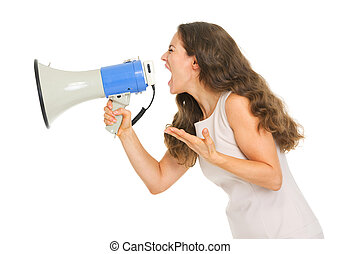 Angry young woman shouting through megaphone