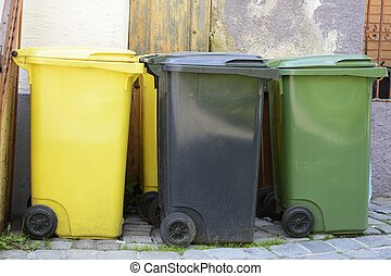Waste Separation - Three garbage cans in different colors...
