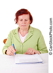 senior woman and paperwork