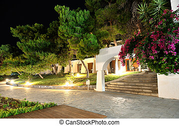 Illuminated villas at luxury hotel, Peloponnes, Greece