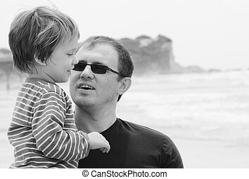 Father and son on the beach in spring time