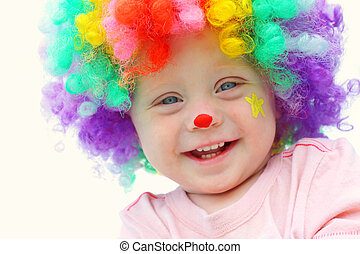 Baby in Clown Costume - A cute, smiling baby boy is dressed...