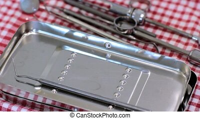 dental instruments - closeup view of a hand and dental...