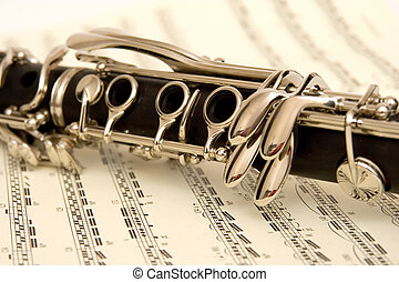 Clarinet and Music - A wooden clarinet on a piece of sheet...