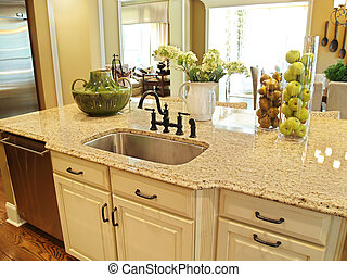 Kitchen Island - A granite topped island counter in a modern...