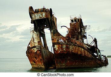 Wrecked dredge - Colour shot of a ship wreck - formally a...