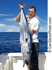Wahoo fish - Lucky fisherman holding a beautiful wahoo fish