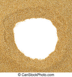sand frame - closeup of a pile of sand with a round hole in...