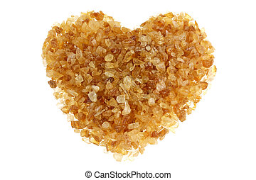 Brown sugar with a shape of heart, isolated on a white...