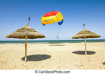 Parasailing on the beach of the Mediterranean in Tunisia