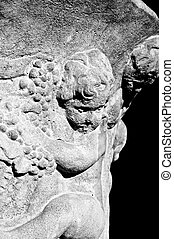 carved cherubs - black and white image of old carved cement...