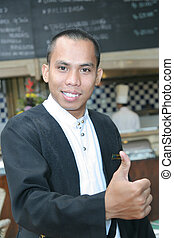man in waiter uniform at work