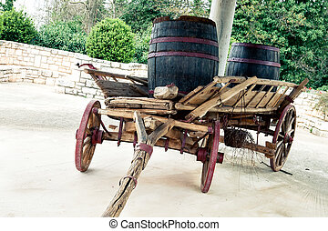 Old cart, standing in the courtyard of the farm.