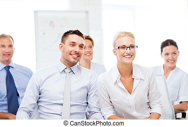 businessmen and businesswomen on conference - picture of...
