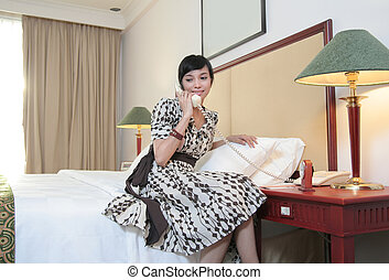 hotel guest calling in hotel or motel room smiling