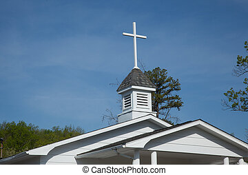 Country church - The cross and steeple of white country...