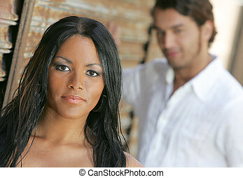 interracial couple together - man and woman posing together...