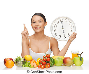 woman with fruits, vegetables and clock - after six o'clock...