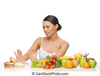 woman with fruits rejecting hamburger - picture of woman...
