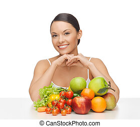happy woman with lot of fruits and vegetables