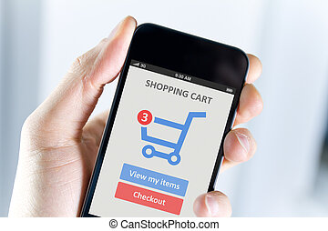 Mobile shopping - Mens hand holding modern mobile phone with...