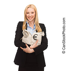 businesswoman holding money bags with euro - young...