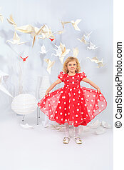 birds of paper - Cute little girl standing in a white room...