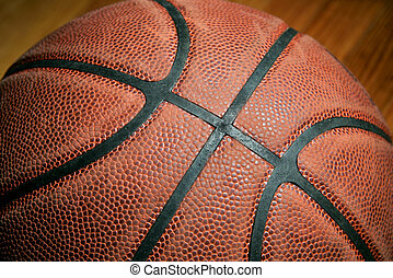 closeup basketball - dark low key basketball closeup with...