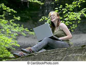 woman with laptop at falls - beautiful girl with laptop...