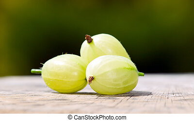 Gooseberries with green nature background - Some...