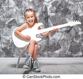 little girl with her guitar - beautiful little girl in white...