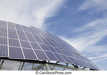 Group of Solar Panel Modules Against Blue Sky with Clouds