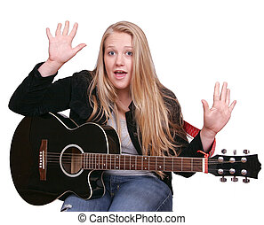 girl in black playing guitar - young woman in a black...