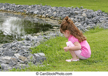 girl by the water - one young female child near the water's...