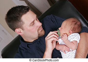 adult man and newborn baby - a father holding his newborn...