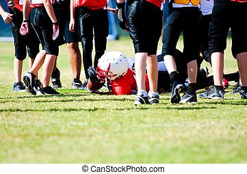 Youth football boy after tackle - Tackled football boy in...