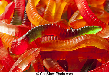 Colorful Fruity Gummy Worm Candy on a background