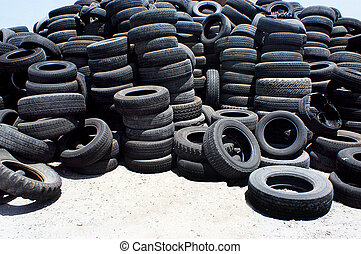 Pile of used rubber tyres