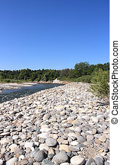 Ticino River - Water stream and gravel bed of the Ticino...