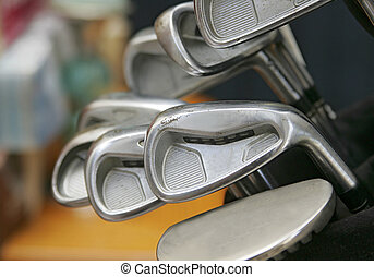 golf clubs - a group of golf club heads in the bag