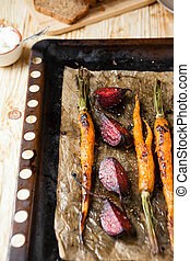 roasted vegetables on a baking tray, food close up